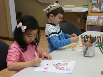 photo - White Rock / South Surrey Jewish Community Centre Religious School students work on their entries to the Jewish Independent's annual Chanukah cover art contest