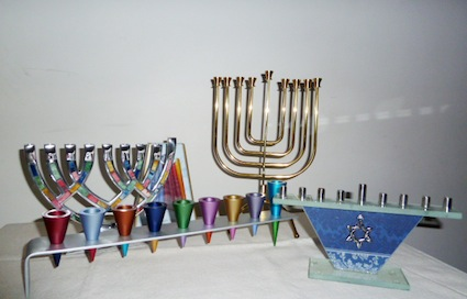 photo - Beth Tikvah's gift store offers several different styles of menorot and a host of other Chanukah gifts, including shaped cookie cutters, games and books