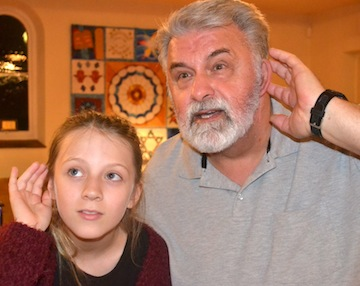 photo - Sam (played by Toshik Bukowiecki) and his granddaughter Ellen (Ava Fournier) listen for the sounds of voices in the synagogue walls in The Original Deed, at Congregation Emanu-El this month