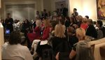 photo - A sold-out crowd attended CJPAC's Women in Politics Pecha Kucha event on Oct. 24, which featured four speakers, including CJPAC's Sherry Barad Firestone (standing on the left)