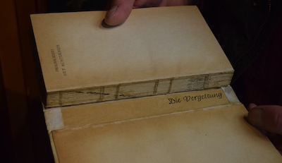 "photo - In the spine of this 1947 edition of The Diary of a Young Girl is a piece of paper with the German words, ""Die Vergeltung,"" or retribution"
