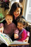 photo - Bracha Goetz reads from one of her recent books to her two grandchildren