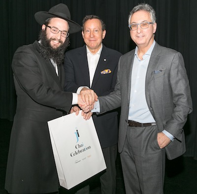 photo - JI's 18 Under 36er Rabbi Levi Varnai, left, with JI Chai Celebration presenting sponsors Lorne Segal, centre, and Gary Segal