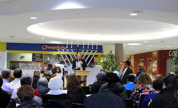 photo - Chazzan Yaakov Orzech lit the chanukiyah and got everyone to join him in singing some Chanukah favourites