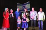 photo - Alexandra Gerson, centre, says a few words at a Jewish talent show put on by Radio VERA last year