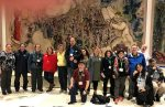 "photo - Participants in last year's Inclusion Journey at the Knesset in Jerusalem, in front of Marc Chagall's painting ""The Exodus"""