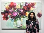 photo - Artist Lauren Morris at the opening of her solo show, Dressed in Colour, at the Zack Gallery Jan. 25