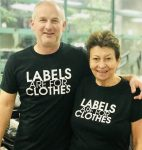 "photo - Eldad Goldfarb, executive director of the Jewish Community Centre of Greater Vancouver, and Jewish community member Shirley Barnett show off their ""Labels are for Clothes"" T-shirts"
