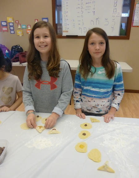 photo - In preparation for Purim, students of White Rock South Surrey JCC Religious School baked hamantashen to take home and share with their families