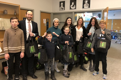 photo - Several VHA students and teachers delivered the mishloach manot bags to the Jewish Food Bank on Feb. 22