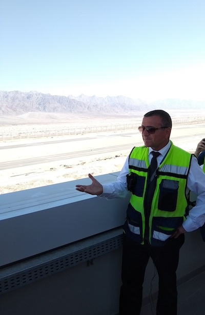 photo - Ramon International Airport manager Hanan Moscovitz at a March 19 media tour of the new facility