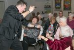 photo - Magician Stephen Kaplan entertains at last month's Empowerment session