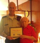 photo - Isaac Messinger being presented with a certificate of appreciation last year for his contributions to the Jewish National Fund of Canada and Beit Halochem