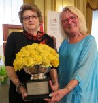 photo - Marie Doduck, left, receives the CHILD Foundation Inspiration Award from the foundation's Mary McCarthy Parsons