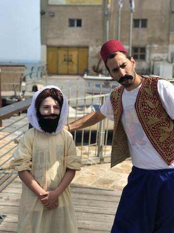 photo - Max Dodek dressed as Aaron Chelouche, founder of Neve Tzedeck, and Noam Rumsack, the guide