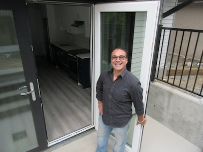 photo - Avie Estrin outside of Yaffa's new laneway house