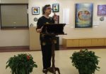 photo - Barbara Pelman speaks at the opening of the exhibit Encounters, which is at Congregation Emanu-El in Victoria this summer