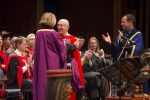 photo - Honourary degree recipient Robert Waisman, centre, is congratulated by University of Victoria chancellor Shelagh Rogers as UVic president Jamie Cassels, right, applauds.