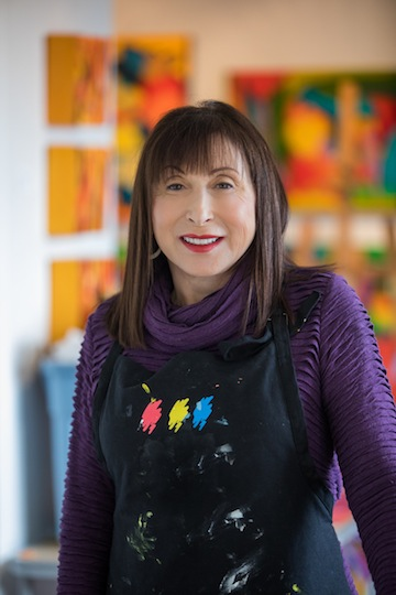 photo - Melanie Fogell's art is bright and flamboyant, totally abstract, and her canvases are large