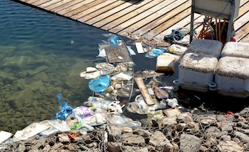 photo - Plastic waste accumulates in an inlet along Eilat's Red Sea coast. A worldwide problem, much is being done in Israel to manage the correct disposal of plastic, paper and glass