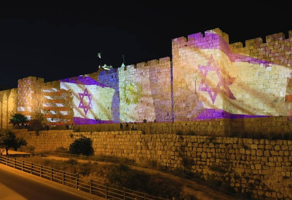 photo - The Guatemalan flag is projected on Jerusalem's Old City walls in anticipation of Guatemala moving its embassy from Tel Aviv to Jerusalem