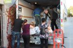 photo - More than 80 volunteers came together to help Jewish Family Services sort the food on Sept. 26, organizing nearly 1,300 bags of food and toiletries