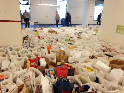 photo - Nearly 1,300 bags of food and toiletries
