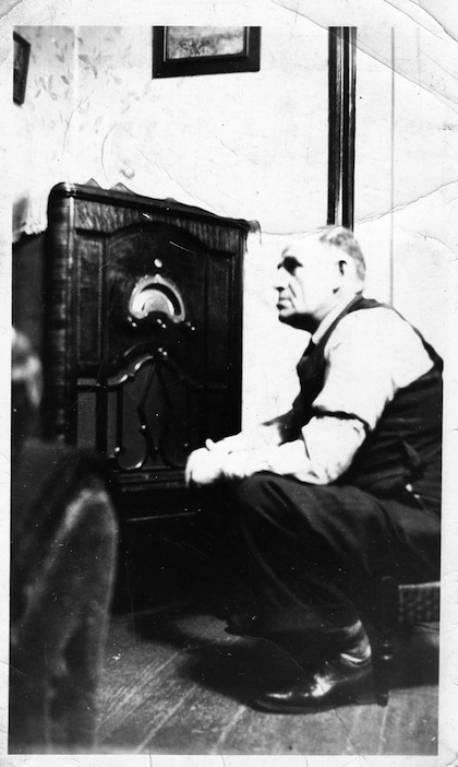 photo - The writer's father listening to the radio, circa 1940