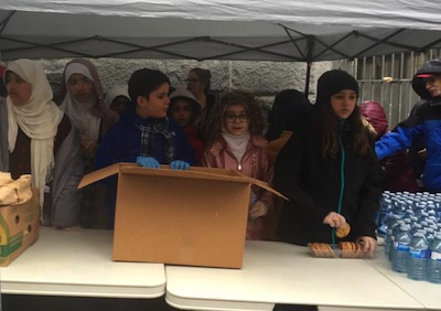 photo - Students in grades 6 and 7 hand out sandwiches on the Downtown Eastside Nov. 15