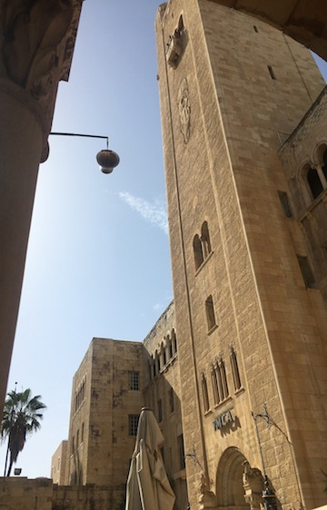 photo - The new bell being lifted to the top of the YMCA tower in Jerusalem