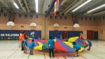photo - Campers play with a parachute