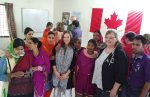 photo - Marianne Hladun, second from the right, and fellow delegation member Melanie McConnell (chair of Women of Steel committee for USW Local 7619, Kamloops, B.C.), fifth from the right, at the Bangladesh Centre for Worker Solidarity in 2016. The other women are volunteers who work to promote unions in the factories, and health and safety
