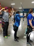 photo - Adi Shapira (centre) willcompete in archery in the 2019 Canada Winter Games