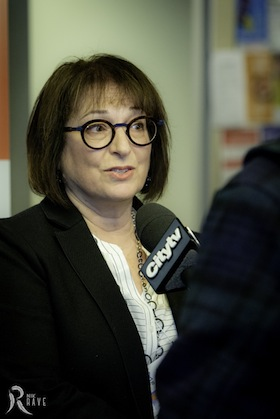 photo - Ivy Kopstein, coordinator of the substance use and addictions program at Jewish Child and Family Service of Winnipeg, answers a question from CityTV at the forum Wide Awake