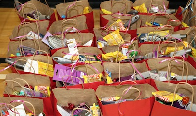 photo - Volunteers put together 1,200 care packages, which were distributed to those in need by various social services agencies and programs