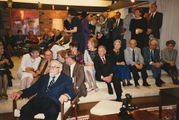 photo - Photographs from an unidentified event, possibly a University of British Columbia event, likely in honour of Harry Adaskin, 1985. In the photo immediately below, of the women socializing by the piano, Shirley Kort is second from the right