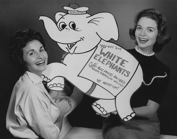 photo - Two unidentified women hold a White Elephant sign for Hadassah Bazaar collection, 1953