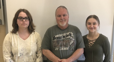 photo - Springfield Collegiate Institute student Ana Palidwor, left, teacher James Chagnon, centre, and student Madison Stojak