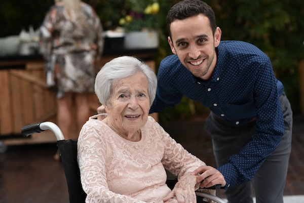 photo - Elad Pelleg and his grandmother, Dvora. Pelleg shared his family's story during the community's Yom Hazikaron ceremony May 7