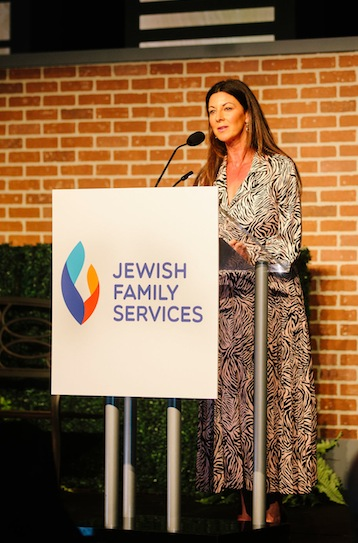 photo - JFS board member Jody Dales spoke about her own family's struggles