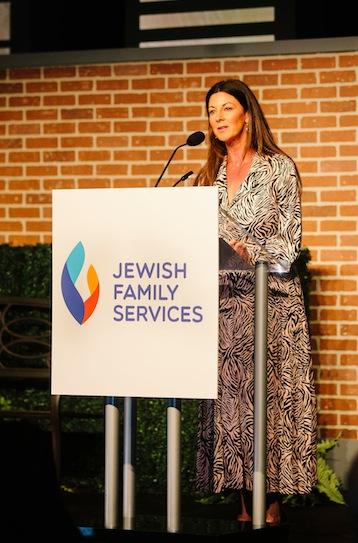 photo - JFS board member Jody Dales spoke about her own family's struggles