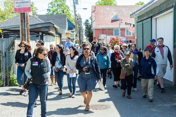photo - Vanessa Richards of the Hogan's Alley Society leads guests down Hogan's Alley