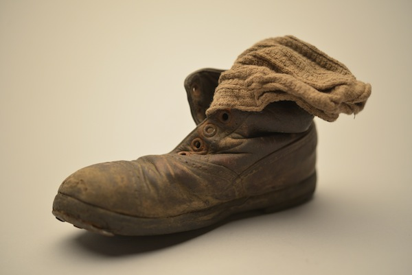 photo - This child's shoe and sock were found in January 1945 among thousands of others at Auschwitz-Birkenau, abandoned by the Nazis as the Red Army approached
