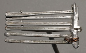 photo - Determined to survive, and to have a head of hair again one day, Ruth Grunberger made this comb for herself in Auschwitz, using stolen scrap metal and wire