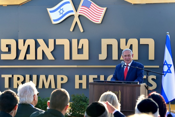 photo - Israeli Prime Minister Binyamin Netanyahu, together with U.S. Ambassador David Friedman, unveiled a sign reading Ramat Trump (Trump Heights) in Hebrew and English