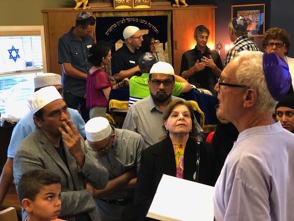 photo - Okanagan Jewish Community Association president Steven Finkleman explains Jewish prayer books
