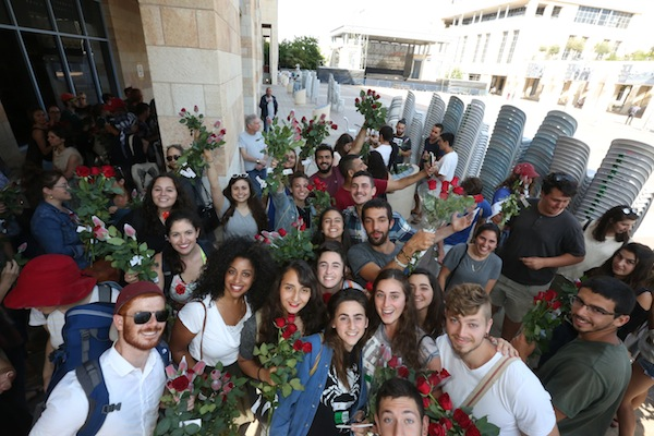 photo - One of Tag Meir's annual events is Flowers of Peace. Participants hand out roses on the streets of the Old City in Jerusalem on Jerusalem Day. This year, they gave out some 2,000 flowers as a message of peace to Muslims and Christians in the city