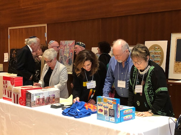 photo - Jewish Seniors Alliance's first silent auction, which offered a selection of close to 30 items, from gift certificates from local businesses to paintings and prints
