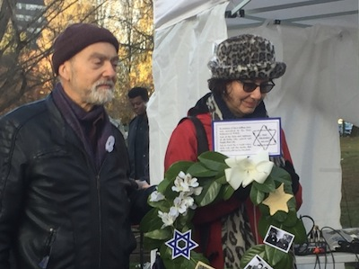 photo - Henry Grayman and Deborah Ross-Grayman with the Holocaust wreath at the memorial last year