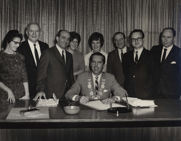 photo - Then-mayor of Vancouver Tom Campbell, centre, with a group of unidentified people, with the exception of Alec Jackson (third from left) and Dave Jackson (sixth from left), in 1968